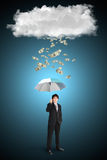 Asian businessman with umbrella and dollar falling from cloud Royalty Free Stock Image