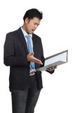 Asian businessman unhappy with a folder Stock Photo
