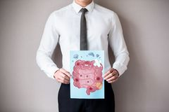 Businessman with ill intestine. Asian businessman with unhealthy intestine and feel worry stock photo