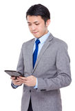 Asian businessman use on the digital tablet pc Stock Photography