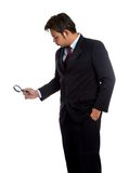 Asian businessman use a  magnifying glass look to something Stock Photos