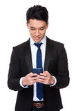 Asian businessman use of mobile phone Royalty Free Stock Photos