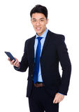 Asian businessman use of the mobile phone. On white background royalty free stock photos