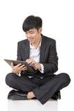 Asian businessman use pad Stock Photography