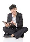 Asian businessman use pad Royalty Free Stock Image