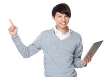 Asian Businessman use of the tablet and finger point up Royalty Free Stock Images
