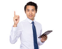 Asian businessman use of tablet and finger pointing up Royalty Free Stock Photo