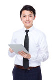 Asian businessman use of tablet pc Royalty Free Stock Images