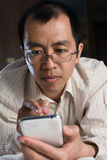 Asian businessman using cellphone Stock Photos