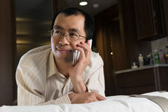 Asian businessman using cellphone Royalty Free Stock Image