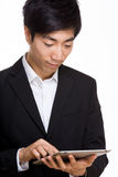 Asian businessman using digital tablet Stock Photography