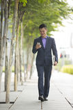 Asian businessman using  his smart phone. Royalty Free Stock Photos