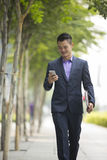 Asian businessman using  his smart phone. Stock Images