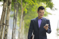 Asian businessman using  his smart phone. Royalty Free Stock Image