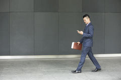 Asian businessman using  his smart phone. Stock Photo
