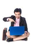 Asian businessman using laptop, isolated on white background Stock Images