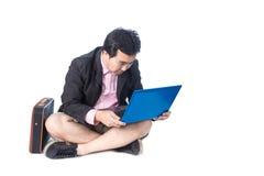 Asian businessman using laptop, isolated on white background Stock Photo