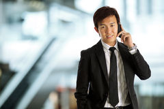 Asian Businessman Using Mobile Phone Stock Photo