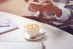 Asian businessman using mobile phone  during coffee break on tab Stock Photography