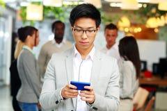Asian businessman using smartphone Stock Photography