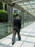 Asian Businessman Walking. Through the corridor of power Royalty Free Stock Photography