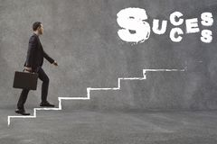 Asian Businessman walking up the stairs to find success.Conception of Business Success stock photography