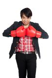 Asian businessman wear boxing gloves ready to fight Stock Photography
