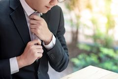 Asian businessman wearing black suit royalty free stock photography
