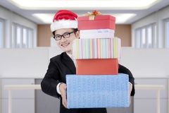 Young businessman carrying Christmas gifts Stock Image