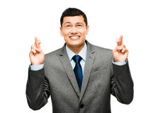 Asian businessman wishing hoping Royalty Free Stock Photography