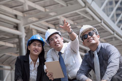 Asian businessman and woman discuss with engineer architect prof Stock Image