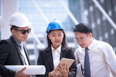 Asian businessman and woman discuss with engineer architect prof Royalty Free Stock Photo