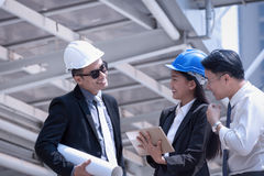 Asian businessman and woman discuss with engineer architect prof Stock Images
