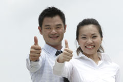 Asian businessman and woman with their Thumbs Up Stock Photos
