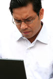 Asian businessman working on laptop Royalty Free Stock Images
