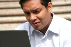 Asian businessman working on laptop Stock Images