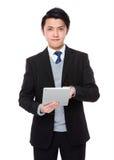 Asian businessmann use of the tablet pc Stock Photos