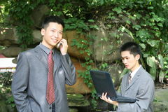 Asian businessmen Stock Images