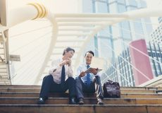 Asian businessmen are discussing joint business meetings in the. City stock photos