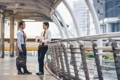Asian businessmen are discussing joint business meetings in the. City royalty free stock photos