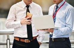 Asian businessmen are discussing joint business meetings in the. City stock images