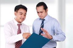 Asian Businessmen doing Business Conversation Royalty Free Stock Photos