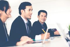 Asian businessmen and group using notebook for business partners royalty free stock photo