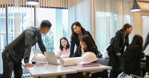 Asian businessmen and group using notebook for business partners stock photo