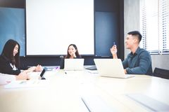 Asian businessmen and group using notebook for meeting and busin royalty free stock image