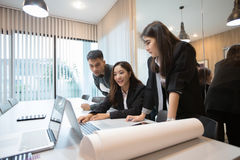 Asian businessmen and group using notebook for meeting and busin. Ess women smiling happy for working Royalty Free Stock Photography