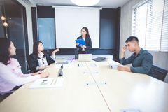 Asian businessmen and group using notebook for meeting serious a royalty free stock images