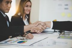 Asian Businessmen handshaking after successful business meeting. Goals, business deals concept Royalty Free Stock Images