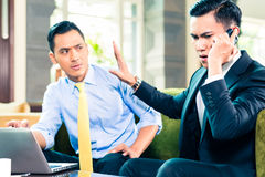 Asian Businessmen having meeting Stock Photos