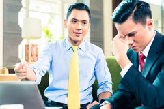 Asian Businessmen having meeting Stock Images
